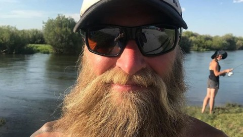 Portrait of a wild man rocking our Let 'er Buck truckerhat. #seekthestoke #staywild