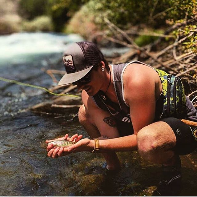@adventure__is_out__there hauling in the big fish and rocking our Vintage Teton SnapBack hat. ? #seekthestoke #fishing #handcraftedintheTetons